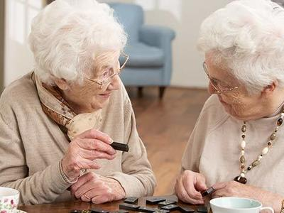 Elderly women playing dominoes