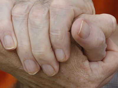 Elderly hands holding